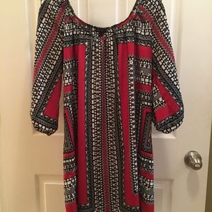 Red black and white patterned dress